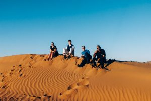 Charity Challenge group trekking across the Sahara Desert