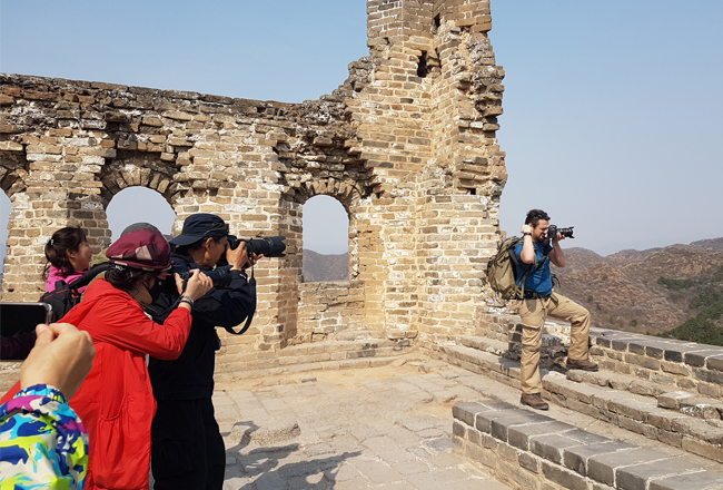 Tourists taking photos in China on the Great Wall